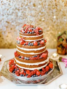 Berry covered naked cake :http://www.stylemepretty.com/destination-weddings/2015/03/17/vintage-chic-irish-wedding-at-castle-durrow/ | Photography: Lisa O'Dwyer - http://www.lisaodwyer.com/