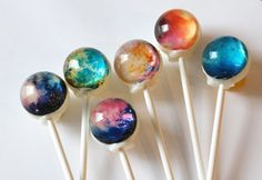 These are crazy cool!!! Nebula Lollipops from The Colossal Shop. They also make some Solar System lollipops... Unfortunately, these are $14.95 for 6!!! And th solar system ones are $22!!! Crazy price!!!