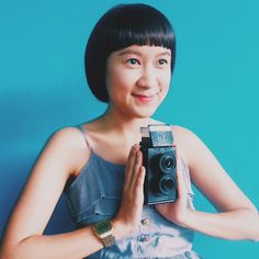 A girl in short hair with twin lens reflex camera DIY , film camera 35mm. At Mamie Lomo Shop Cnx Chiangmai Thailand.