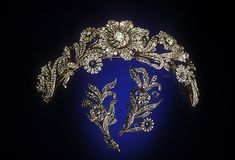 """The Post Diamond Tiara - early Victorian c1840. The flower petals and leaves are pavé set with 1,198 old mine and rose cut diamonds.  Fashioned """"en tremblant;"""" the flowers were mounted on trembler springs so that every movement would enhance the brilliance and sparkle of the diamonds."""