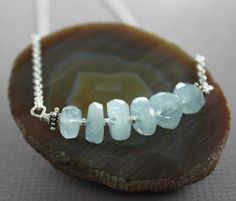 Beautiful top quality blue aquamarine nugget stones stranded on sterling silver wire and finished up with rolo sterling silver chain and lobster clasp. All metal components are sterling silver. Please see matching earrings here. https://www.etsy.com/shop/IngoDesign/search?search_query=aquamarine+silver+earrings&order=date_desc&view_type=list&ref=shop_search  The beaded row is approximately 2(5.0cm) from side to side.  PLEASE NOTE: THESE STONES VARY IN SIZES AND SHAPES. ★ ★ ★ ★ ★ ★ ★ ★ ★…