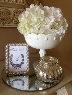Milk glass and Mercury glass for a wedding centerpiece  ~   www.somethingborrowedmn.net