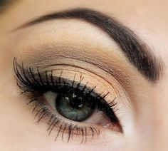 Soft brown eyeshadow and winged eyeliner for an everyday look.