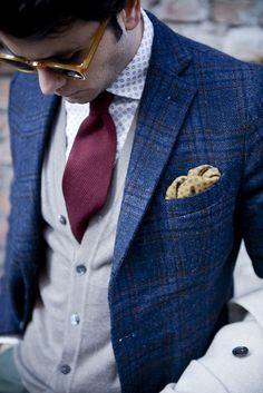Shop this look for $427:  http://lookastic.com/men/looks/blazer-and-pocket-square-and-tie-and-longsleeve-shirt-and-cardigan/1160  — Blue Plaid Blazer  — Yellow Polka Dot Pocket Square  — Burgundy Tie  — White and Blue Polka Dot Longsleeve Shirt  — Grey Cardigan
