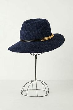 Blue anthro hat with gold rim.