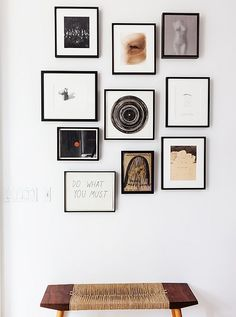 A wabi-sabi-style bench, a gallery wall of small-scale art (tied together by the black frames) lies just inside the entry of Jenni Kayne's home.