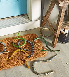 Cover your doormat with a den of lifelike snakes to give trick-or-treaters a serpentine greeting. #Halloween