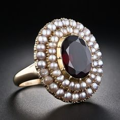 Garnet and seed pearl ring, A ravishing antique ring featuring a deep almondine garnet encircled by a double row of shimmering natural seed pearls. Although we believe this ring dates back to the mid-to-late-nineteenth century, the inside hand engraving reads 'LW __ 30-09'