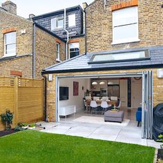 This contemporary extension has completely revived this dated Victorian, end of terrace. Open planning the rear reception with the kitchen has allowed the family to realise their dream of creating . Kitchen Extension Exterior, Kitchen Extension Open Plan, House Extension Plans, House Extension Design, House Design, Roof Extension, Extension Ideas, Terrace House Exterior, Victorian Terrace Interior