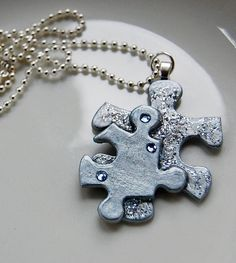 Upcyled silver puzzle piece art charm with crystals