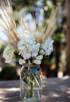 wheat in the bouquet/  I like this.  very easy, country and a box of mason jars is about $10 each for 12 plus depending on size