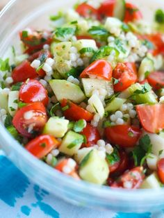 Couscous tabbouleh w. cucumbers & tomatoes:  3 tablespoons olive oil, 1 garlic clove, minced, 3/4 cup Israeli couscous, 1 cup chicken or vegetable broth, juice of 1 lemon, salt & pepper, 1/2 cup flat leaf parsley, chopped, 1/2 cup mint, chopped, 1/4 cup chives, snipped,   1 pint grape tomatoes, quartered  1 seedless cucumber, peeled and chopped. refrigerate 20 minutes.