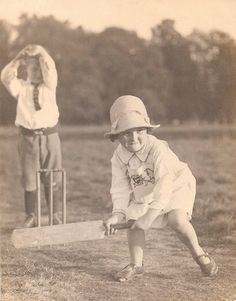 Backyard cricket.. Girls whipping the boys! Love the wee toe peeping through the shoe.