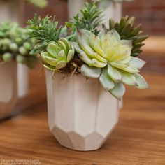 """Beautiful Renew geometric vase in ivory with beige lines. This ceramic vase has a unique geometric design that makes it a stylish choice to accent your modern wedding! - 4"""" Diameter x 4.25"""" Tall - Cer"""