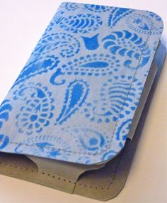 Cell phone wallet made out of durable paintable kraft•tex™. Designed by Sophie Wood
