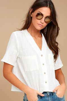 Let the good times begin with the Lift my Spirits White Button-Up Crop Top! Gauzy woven cotton creates a collarless neckline, short sleeves, and a cropped, wide-cut bodice with front patch pockets. Full button placket.