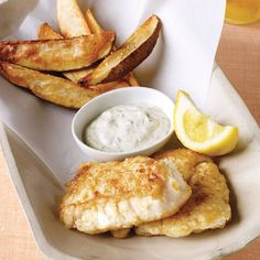 Oven-roasted potato wedges and savory fat-free tartar sauce turn this British comfort meal into a healthful treat. Kids will clamor for the golden-fried cod fingers.