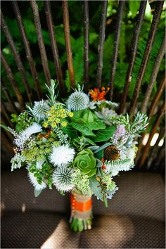 Green and orange wedding bouquet ideas. Floral Design: Laughin' Gal Floral ---> http://www.weddingchicks.com/2014/05/30/fill-your-wedding-with-beautiful-traditions/