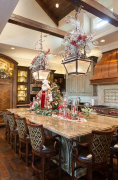Love the holiday decor on the lights. Gorgeous kitchen
