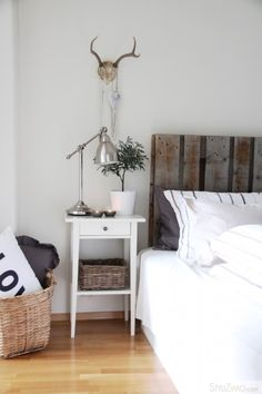 I just bought the same nightstands from Ikea for the guest bedroom...and I love the way they are styled here.