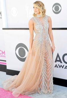ACM Awards 2017 Red Carpet Fashion: Carrie Underwood in a sheer, bejewelled stunner by Labourjoisie, accessorized by Harry Kotlar diamond earrings, a Hearts on Fire diamond band and Djula rings.