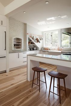Modern White Kitchen Wood Floor kitchen. kitchen with white cabinets and wide hardwood plank