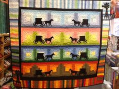 This quilt was made by Ruthie Snell using a Row by Row Experiencew block from Shipshewana.