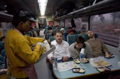 A waiter serves breakfast to passengers onboard the early morning Shatabdi Express train from New Delhi to Agra #India