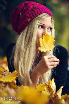 Girl in the middle of Autumn leaves