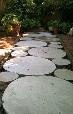 Outdoor Areas: Circular concrete walkway for backyard area Stepping Stone Pathway, Concrete Walkway, Diy Concrete, Cement, Round Stepping Stones, Concrete Stepping Stones, Paver Walkway, Gravel Path, Stone Walkway