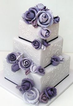 Stunning three tiered wedding cake with lovely shades of purple. #penningtonscakes #weddingcake #purplecake