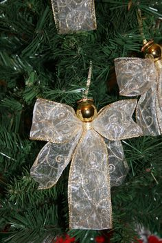 3 Handmade Christmas Ribbon Angel Ornaments -  White with Gold Glitter Swirls Ribbon. $7.00, via Etsy.