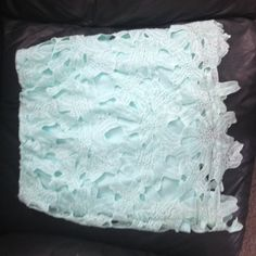 Mint lace skirt Mint lace overlay skirt. Can be worn high waist or low. Tight fit. Worn once. Necessary Clothing Skirts