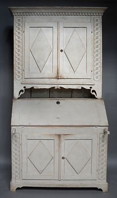 "Wonderful rural interpretation of the late Gustavian style in a two part secretary from Ångermanland, Sweden, circa 1820.  H:85"", W:47½"", D:21"" (35"" open).  Ref. #31-40"