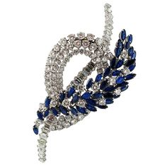 Large 1950s French Sapphire and Diamond Brooch | From a unique collection of vintage brooches at https://www.1stdibs.com/jewelry/brooches/brooches/