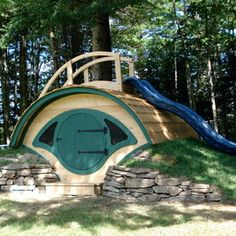 Woodshire Hobbit Hole Playhouse / Outdoor Playset - LOVE the slide on the top.