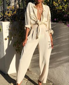 100% silk button down blouse. Gorgeous draping to the fabric Fits s-l $42 SOLD Cream high waisted crepe pleated trousers. Size 26-27 waist $68 SOLD