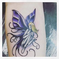 Vibrant blue fairy tattoo design for women