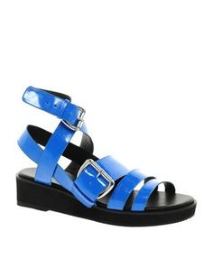 The only way to make a flatform sandal more noticeable is to add some thick neon straps.