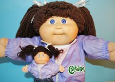 This sweet little girl is named Penny Viola and she loves playing with her little twin mini-me doll. Penny is an Ok factory, brown signature (1st