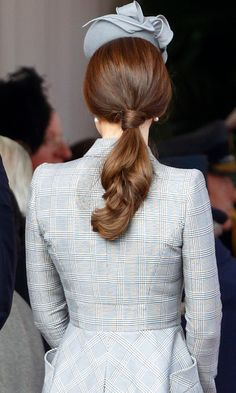 Steps:  Set the hair in a full head of big velcro rollers, shake the hair out and apply a small amount of back combing on the crown.   Carefully brush the hair back into a pony tail, followed by wrapping a small piece of hair around so it hides the head band for that softer look.   Finish by brushing the pony tail with a wide tooth comb leaving the movement at the end from the rollers.