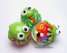 Tongue Tied Frogs.  Lampwork glass beads by Heather Sellers.