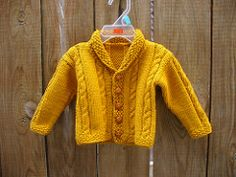 This is a beautiful baby cardigan to be treasured for generations. (Lion Brand Yarn)