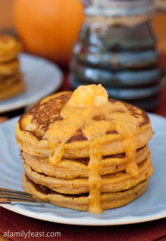 Pumpkin Pancakes with Maple Pumpkin Butter - Delicious moist pumpkin pancakes with butter that has been infused with maple syrup and pumpkin. #sponsored