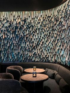 Designer Raphael Navot has used oxidised copper tubes to create a unique and interesting accent wall in a restaurant within a hotel. #AccentWall #Copper #Design