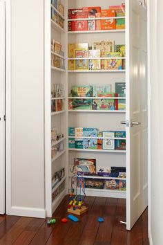 Fantastic use of the awkward behind-the-door space- turn it into shelving for books. Via Design Sponge