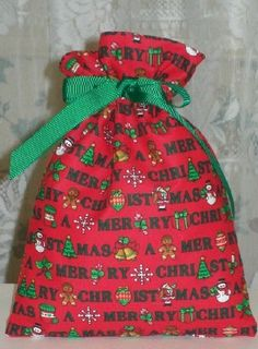 Merry Christmas on Red Small Fabric Gift Bag by funbagsforeveryone, $4.00