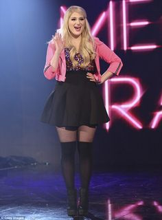 Hitting the high notes: Meghan Trainor wowed in little black skirt and pink jacket while performing at the Dancing With The Stars 19th season finale on Tuesday