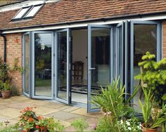 I want a lot of these doors in my living room and dining room, so we can extend our indoor space to the outdoor space. I envision more windows above the doors, allowing a lot of natural light. The Doors, Entrance Doors, Garage Doors, Folding Patio Doors, Aluminium Windows And Doors, Patio Enclosures, Door Images, External Doors, My Living Room