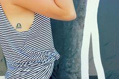 libra zodiac tattoo on rib